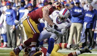 Washington Redskins outside linebacker Ryan Kerrigan (91) tackles Buffalo Bills quarterback Tyrod Taylor (5) during the first half of an NFL football game in Landover, Md., Sunday, Dec. 20, 2015. (AP Photo/Mark Tenally)