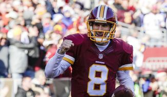 Washington Redskins quarterback Kirk Cousins (8) celebrates his touchdown during the first half of an NFL football game against the Buffalo Bills in Landover, Md., Sunday, Dec. 20, 2015. (AP Photo/Mark Tenally) **FILE**
