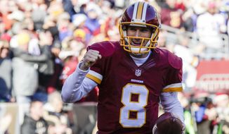 Washington Redskins quarterback Kirk Cousins (8) celebrates his touchdown during the first half of an NFL football game against the Buffalo Bills in Landover, Md., Sunday, Dec. 20, 2015. (AP Photo/Mark Tenally)