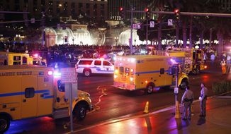 Police and emergency crews respond to the scene of a car accident along Las Vegas Boulevard on Sunday in Las Vegas. (Associated Press)