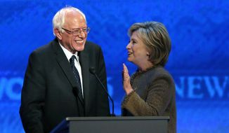 Hillary Clinton, right, speaks to Bernie Sanders during a break at the Democratic presidential primary debate Saturday, Dec. 19, 2015, at Saint Anselm College in Manchester, N.H. (AP Photo/Jim Cole) ** FILE **
