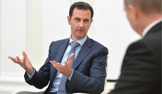Behind the scenes, the White House is embracing a strategy that would leave the Syria President Bashar Assad in place as the world unites against a greater immediate threat from Islamic State terrorists. (Associated Press)