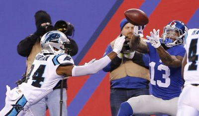 New York Giants' Odell Beckham (13) catches a pass for a touchdown in front of Carolina Panthers' Josh Norman (24) during the second half of an NFL football game Sunday, Dec. 20, 2015, in East Rutherford, N.J. (AP Photo/Kathy Willens)