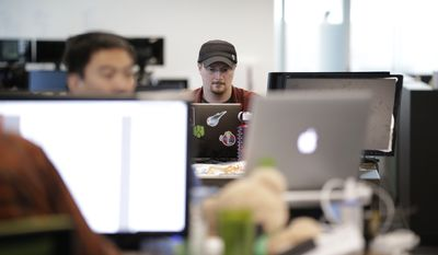 In this Wednesday, Oct. 21, 2015, file photo, Brian Wallace, a security researcher at Cylance, works on his computer in Irvine, Calif. Wallace was on the trail of hackers who had snatched a California university's housing files when he stumbled into a larger nightmare: Cyberattackers had opened a pathway into the networks running the United States power grid. (AP Photo/Jae C. Hong)