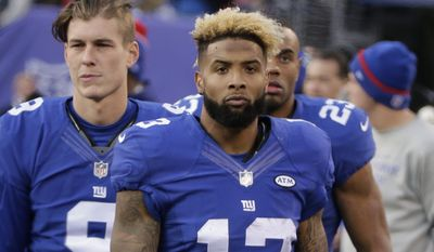 New York Giants' Odell Beckham (13) stands on the sidelines during the second half of an NFL football game against the Carolina Panthers Sunday, Dec. 20, 2015, in East Rutherford, N.J. (AP Photo/Peter Morgan)