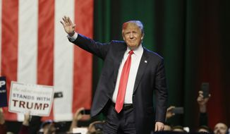 Republican presidential candidate businessman Donald Trump acknowledges the crowd before addressing supporters at a campaign rally in Grand Rapids, Mich., in this Dec. 21, 2015, file photo. (AP Photo/Carlos Osorio) **FILE**