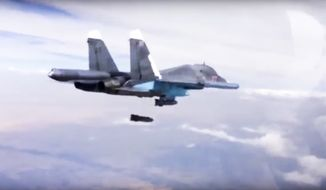 In this Dec. 9, 2015 file photo made from video footage provided by the Russian Defense Ministry, a Russian Su-34 bomber drops bombs on a target. A new report by a human rights watchdog group accuses Russia of using cluster munitions and unguided bombs on civilian areas in Syria in attacks that it says have killed hundreds of people. (Russian Defense Ministry Press Service via AP, File)