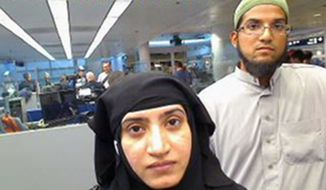 FILE - This July 27, 2014 file photo provided by U.S. Customs and Border Protection shows Tashfeen Malik, left, and her husband, Syed Farook, as they passed through O'Hare International Airport in Chicago. The attack in San Bernardino, California, that left 14 people dead represented a type of extremist plot law enforcement authorities consider exceedingly difficult to detect: a conspiracy between close family members. (U.S. Customs and Border Protection via AP, File)