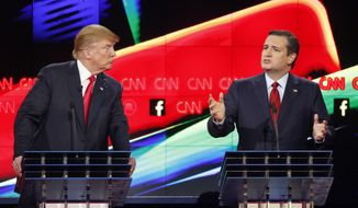 In this Dec. 15, 2015, file photo, Donald Trump, left, watches as Ted Cruz speaks during the CNN Republican presidential debate at the Venetian Hotel & Casino in Las Vegas. (AP Photo/John Locher) ** FILE **