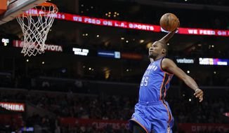 Oklahoma City Thunder's Kevin Durant goes up for a dunk during the second half of an NBA basketball game against the Los Angeles Clippers, Monday, Dec. 21, 2015, in Los Angeles. The Thunder won 100-99. (AP Photo/Jae C. Hong)