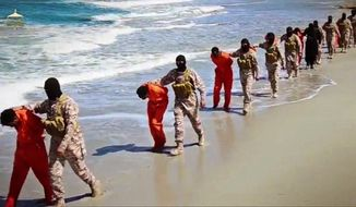 EDS NOTE: GRAPHIC CONTENT - This image made from video posted online April 19, 2015 by supporters of the Islamic State militant group on an anonymous photo sharing website, members of an IS affiliate walk captured Ethiopian Christians along a beach in Libya. The video purportedly shows two groups of captives: one held by an IS affiliate in eastern Libya and the other by an affiliate in the south. A masked militant delivers a long statement before the video switches between footage that purportedly shows the captives in the south being shot dead and the captives in the east being beheaded on a beach. (Militant video via AP, File)