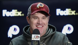 Washington Redskins head coach Jay Gruden answers questions during the post game press conference after an NFL football game against the New Orleans Saints in Landover, Md., Sunday, Nov. 15, 2015. The Redskins defeated the New Orleans Saints 47-14. (AP Photo/Alex Brandon)
