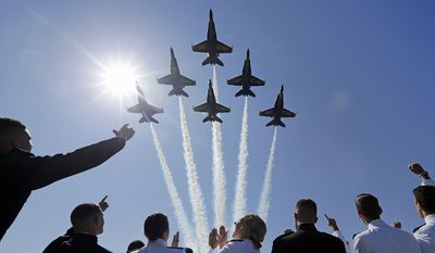 The Blue Angels flight demonstration team flies over graduating members of the U.S. Naval Academy during a graduation and commissioning ceremony, Friday, May 22, 2015, in Annapolis, Md. (AP Photo/Patrick Semansky)