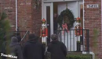 A series of prank videos showing a group of large black men singing Christmas carols in wealthy Louisville neighborhoods is going viral. (WDRB)