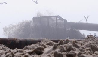 This May 7, 2015 photo shows beach replenishment work under way on a fog-shrouded beach in Ship Bottom, N.J. in the central portion of Long Beach Island. On Wednesday, Dec. 23, 2015, New Jersey's environmental commissioner criticized a decision by the U.S. Army Corps of Engineers to allow its contractor to halt work on the southern portion of long Beach Island for the winter while it diverts the equipment to projects in other parts of the country. (AP Photo/Wayne Parry)