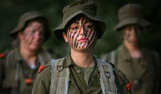 Light duty: Israel Defense Forces restrict female conscripts to support roles in special operations and limit battle service to two light infantry border units. (ASSOCIATED PRESS)