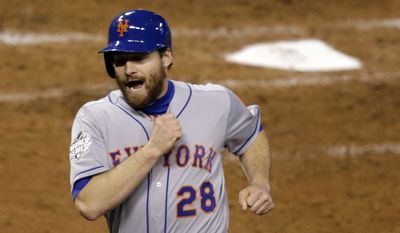 New York Mets' Daniel Murphy reacts as he scores from second on a hit by Lucas Duda during the fourth inning of Game 2 of the Major League Baseball World Series against the Kansas City Royals Wednesday, Oct. 28, 2015, in Kansas City, Mo. (AP Photo/David Goldman)