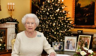In this Dec. 10, 2015, photo, Britain's Queen Elizabeth II sits at a desk in the 18th Century Room in Buckingham Palace in London, after recording her Christmas Day broadcast to the Commonwealth, to be broadcast Friday, Dec. 25, 2015. (John Stillwell/Pool Photo via AP)