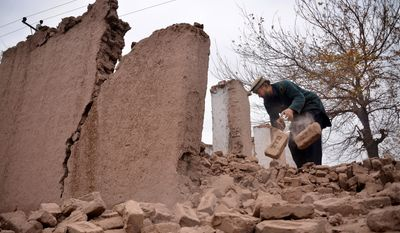 An Afghan villager removes bricks after his home was damaged from an earthquake in Surkhroad district of Jalalabad east of Kabul, Afghanistan, Saturday, Dec. 26, 2015. At least 12 people have been injured and hospitalized in eastern Nangarhar province after an earthquake jolted Afghanistan around midnight Friday. (Mohammad Anwar Danishyar)