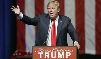 In this photo taken Dec. 21, 2015, Republican presidential candidate, businessman Donald Trump addresses supporters at a campaign rall in Grand Rapids, Mich. The former reality television star and tabloid king has relied on free news coverage to power his presidential campaign. And he wants to control that coverage as much as possible. (AP Photo/Carlos Osorio)
