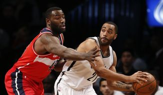 Washington Wizards center DeJuan Blair (45) defends as Brooklyn Nets guard Wayne Ellington (21) looks to pass in the first half of an NBA basketball game, Saturday, Dec. 26, 2015, in New York. (AP Photo/Kathy Willens)
