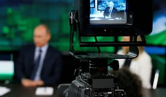 As Russian President Vladimir Putin visits the headquarters of RT, U.S. lawmakers are concerned how Moscow has brought about a propaganda revolution in which America's government-financed news operations have remained largely stagnant in global reach. (Associated Press)