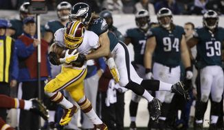 Washington Redskins' Pierre Thomas (39) in action against Philadelphia Eagles' Kiko Alonso (50) in the second half of an NFL football game, Saturday, Dec. 26, 2015, in Philadelphia.  (AP Photo/Matt Rourke)