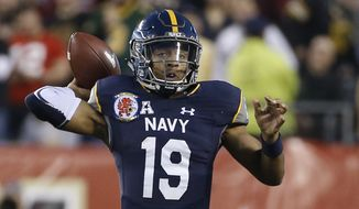 Navy quarterback Keenan Reynolds (19) throws a pass during the first half an NCAA college football game against Army Saturday, Dec. 12, 2015, in Philadelphia. (AP Photo/Matt Slocum)