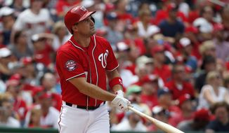 Washington Nationals' Ryan Zimmerman (11), watches his second solo home run during the third inning of a baseball game against the Colorado Rockies at Nationals Park, Sunday, Aug. 9, 2015, in Washington. (AP Photo/Alex Brandon)