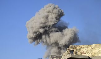 Smoke rises from Islamic State positions following a U.S.-led coalition airstrike, as Iraqi Security forces enter downtown Ramadi, 70 miles (115 kilometers) west of Baghdad, Iraq, Sunday, Dec. 27, 2015. Islamic State fighters are putting up a tough fight in the militant-held city of Ramadi, slowing down the advance of Iraqi forces, Gen. Ismail al-Mahlawi, head of the Anbar military operations, said Sunday. (AP Photo)