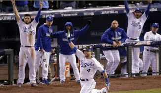 Kansas City Royals' Alex Gordon celebrates a solo home run off New York Mets relief pitcher Jeurys Familia during the ninth inning of Game 1 of the Major League Baseball World Series in Kansas City, Mo. (AP Photo/Charlie Riedel, File)