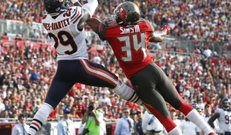 Chicago Bears strong safety Harold Jones-Quartey (29) intercepts a pass by Jameis Winston intended for Tampa Bay Buccaneers running back Charles Sims (34) during the third quarter of an NFL football game Sunday, Dec. 27, 2015, in Tampa, Fla. (AP Photo/Brian Blanco)