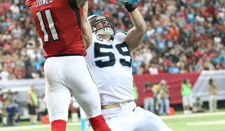 Atlanta Falcons wide receiver Julio Jones (11) makes a catch against Carolina Panthers middle linebacker Luke Kuechly (59) during the second half of an NFL football game, Sunday, Dec. 27, 2015, in Atlanta. Jones scored a touchdown on the play. (AP Photo/John Bazemore)
