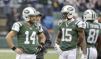 New York Jets quarterback Ryan Fitzpatrick (14) talks to wide receiver Brandon Marshall (15) before an NFL football game against the New England Patriots Sunday, Dec. 27, 2015, in East Rutherford, N.J.  (AP Photo/Seth Wenig)