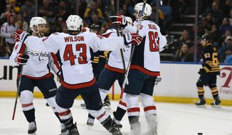 Washington Capitals celebrate a goal by Jay Beagle during the second period of an NHL hockey game against the Buffalo Sabres, Monday Dec. 28, 2015 in Buffalo, N.Y.  Washington won 2-0. (AP Photo/Gary Wiepert)