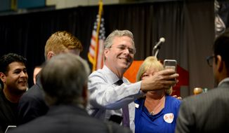 Republican presidential candidate Jeb Bush takes a photo with a Forum Club attendee at the Forum Club of the Palm Beaches on Monday, Dec. 28, 2015, in West Palm Beach, Fla. (Maria Lorenzino/South Florida Sun-Sentinel via AP) ** FILE **