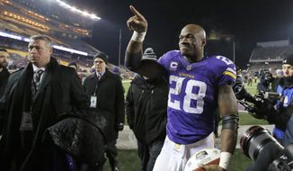 Minnesota Vikings running back Adrian Peterson (28) points to fans as he leavesthe field after the Vikings defeated the New York Giants 49-17 in an NFL football game Sunday, Dec. 27, 2015, in Minneapolis. (AP Photo/Ann Heisenfelt)