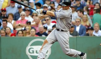 New York Yankees' Stephen Drew hits a three-run home run against the Boston Red Sox during the third inning of a baseball game at Fenway Park in Boston, Wednesday, Sept. 2, 2015. (AP Photo/Winslow Townson)