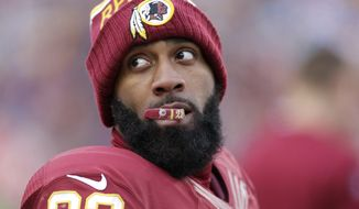 Washington Redskins cornerback DeAngelo Hall (23) looks over his shoulder as he crews on his mouth guard during the second half of an NFL football game against the Buffalo Bills in Landover, Md., Sunday, Dec. 20, 2015. (AP Photo/Mark Tenally)