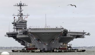 The nuclear aircraft carrier Harry S. Truman approaches the pier at Naval Station Norfolk in Norfolk, Va., on April 18, 2014. (Associated Press)