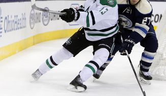 Dallas Stars' Mattias Janmark, left, of Sweden, tries to clear the puck as Columbus Blue Jackets' Ryan Murray defends during the third period of an NHL hockey game Tuesday, Dec. 29, 2015, in Columbus, Ohio. The Blue Jackets won 6-3. (AP Photo/Jay LaPrete)