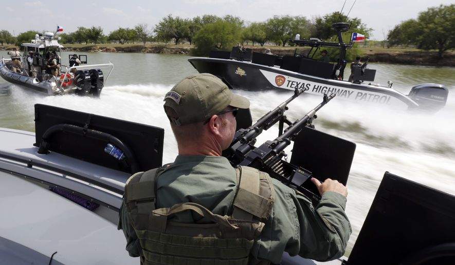 Texas Department of Safety Troopers patrol on the Rio Grand along the U.S.-Mexico border in Mission, Texas, on July 24, 2014. (Associated Press) **FILE**