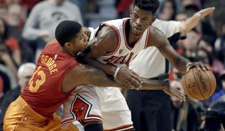 Chicago Bulls; Jimmy Butler, right, drives as Indiana Pacers forward Paul George defends during the first half of an NBA basketball game Wednesday, Dec. 30, 2015, in Chicago. (AP Photo/Nam Y. Huh)