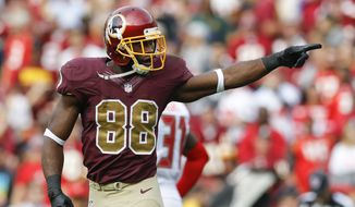 Washington Redskins wide receiver Pierre Garcon (88) points down field during the second half of an NFL football game against the Tampa Bay Buccaneers in Landover, Md., Sunday, Oct. 25, 2015. (AP Photo/Patrick Semansky)