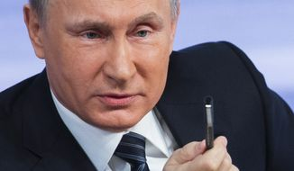 In this Thursday, Dec. 17, 2015 photo, Russian President Vladimir Putin speaks during his annual end of year news conference in Moscow, Russia. Putin says that Russia's economy is showing signs of stabilization despite plummeting oil prices. If the year that was turned out to be daunting, 2016 is shaping up as the European Union's year of living dangerously. (AP Photo/Alexander Zemlianichenko, File)