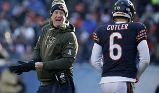FILE - In this Nov. 22, 2015 file photo, Chicago Bears head coach John Fox talks to quarterback Jay Cutler (6) as Cutler walks to the bench during the second half of an NFL football game against the Denver Broncos in Chicago. Fox's new team trailed the Broncos with 10 minutes left when the Bears went for it on fourth-and-goal from the 4. Cutler's pass fell incomplete and the decision not to kick the field goal proved costly when Chicago's 2-point conversion failed in the final minute of a 17-15 loss. (AP Photo/Nam Y. Huh, File)
