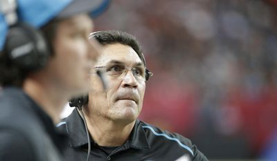 FILE - In this Sunday, Dec. 27, 2015, file photo, Carolina Panthers head coach Ron Rivera watches his team play against the Atlanta Falcons during the first half of an NFL football game in Atlanta. Rivera, who is 18-4 in December games, said he believes his team has the right type of character to put the loss behind them and bounce back. (AP Photo/David Goldman, File)