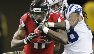 FILE - In this Nov. 22, 2015, file photo, Atlanta Falcons wide receiver Julio Jones (11) makes the catch against Indianapolis Colts cornerback Greg Toler (28) during the second half of an NFL football game in Atlanta. The New Orleans Saints play the Falcons on Sunday, Jan. 3. (AP Photo/John Bazemore, File)