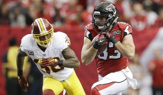 Atlanta Falcons tight end Jacob Tamme (83) runs against Washington Redskins free safety Dashon Goldson (38) during the first half of an NFL football game, Sunday, Oct. 11, 2015, in Atlanta. (AP Photo/Brynn Anderson)