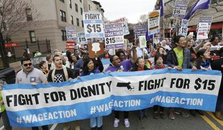 FILE - In this Tuesday, April 14, 2015 file photo, protesters, including college students, fast-food restaurant employees and other workers, display placards and chant slogans as they march in Boston. New laws taking effect on Jan. 1, 2016, will raise the minimum wage in several states, including Massachusetts. (AP Photo/Steven Senne, File)